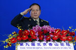 Chinese Defense Minister Wei Fenghe salutes after delivering his opening speech for the Xiangshan Forum, a gathering of the region's security officials, in Beijing, Monday, Oct. 21, 2019. Wei issued a stinging rebuke of the U.S. at a defense forum in Beijing, saying China wasn't fazed by sanctions, pressure and a