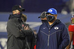 Western Kentucky head coach Tyson Helton, left, and BYU head coach Kalani Sitake speak before an NCAA college football game Saturday, Oct. 31, 2020, in Provo, Utah. (AP Photo/Rick Bowmer, Pool)