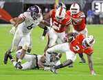 Miami running back Donald Chaney, Jr. (2) runs the ball in the second quarter of an NCAA college football game against Virginia in Miami Gardens, Fla., Saturday, Oct. 24, 2020. (Al Diaz/Miami Herald via AP)