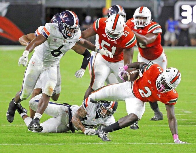 Miami running back Donald Chaney, Jr. (2) runs the ball in the second quarter of an NCAA college football game against Virginia in Miami Gardens, Fla., Saturday, Oct. 24, 2020. (Al Diaz/Miami Herald via AP)