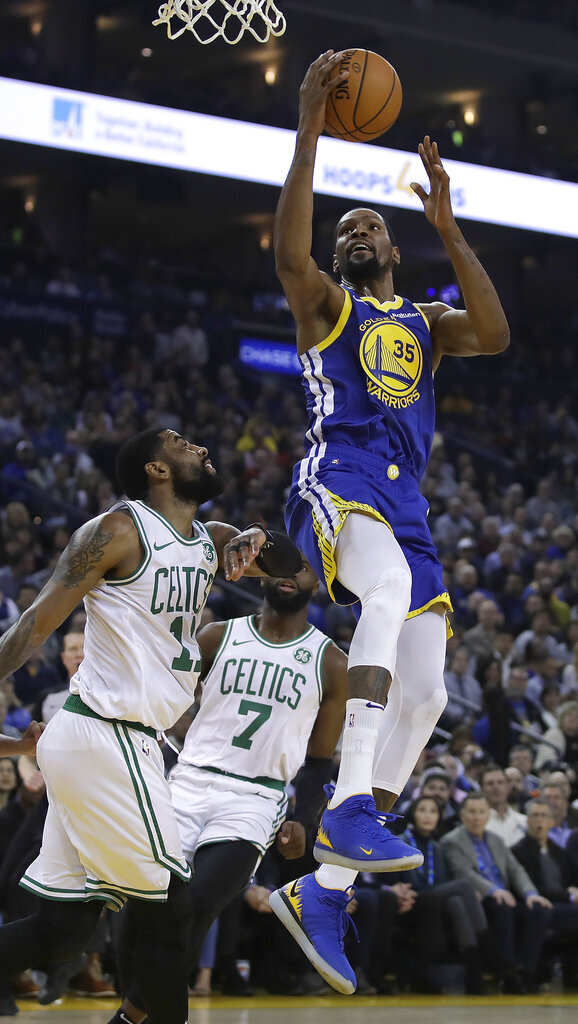 Golden State Warriors' Kevin Durant, right, shoots over Boston Celtics' Kyrie Irving (11) during the first half of an NBA basketball game Tuesday, March 5, 2019, in Oakland, Calif. (AP Photo/Ben Margot)