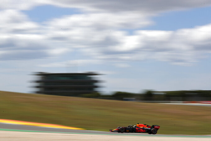 Red Bull driver Max Verstappen of the Netherlands steers his car during the first free practice session ahead of the Portugal Formula One Grand Prix at the Algarve International Circuit near Portimao, Portugal, Friday, April 30, 2021. The Portugal Grand Prix will be held on Sunday. (AP Photo/Manu Fernandez)