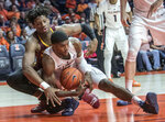 Illinois forward Kipper Nichols (2) grabs a loose ball near Minnesota center Daniel Oturu during the second half of an NCAA college basketball game in Champaign, Ill., Wednesday, Jan. 16, 2019. (AP Photo/Rick Danzl)