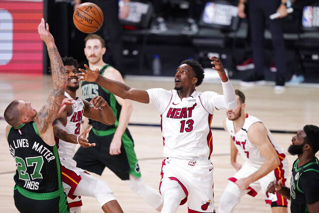 Miami Heat's Bam Adebayo (13) and Boston Celtics' Daniel Theis (27) battle for the ball during the second half of an NBA conference final playoff basketball game Friday, Sept. 25, 2020, in Lake Buena Vista, Fla. (AP Photo/Mark J. Terrill)