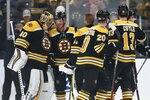 Boston Bruins' Tuukka Rask (40) celebrates with teammates after defeating the St. Louis Blues in an NHL hockey game in Boston, Saturday, Oct. 26, 2019. (AP Photo/Michael Dwyer)