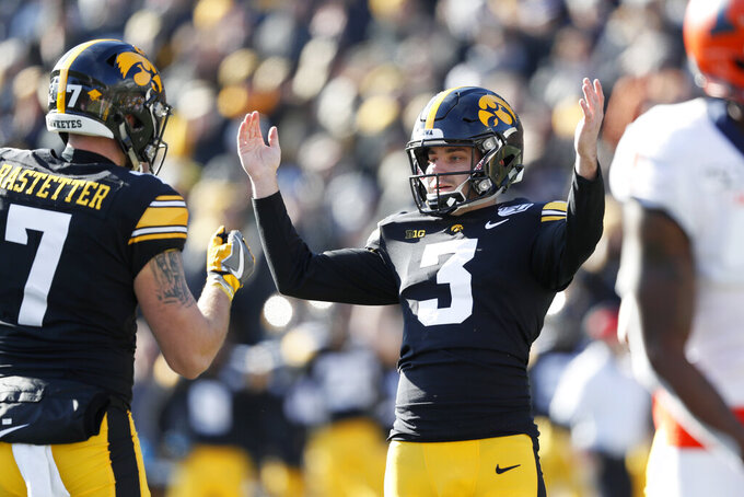 FILE - In this Nov. 23, 2019, file photo, Iowa place kicker Keith Duncan (3) celebrates with teammate Colten Rastetter after kicking a 45-yard field goal during the first half of an NCAA college football game against Illinois, in Iowa City, Iowa. Duncan was selected to The Associated Press All-Big Ten Conference team, Wednesday, Dec. 11, 2019. (AP Photo/Charlie Neibergall, File)