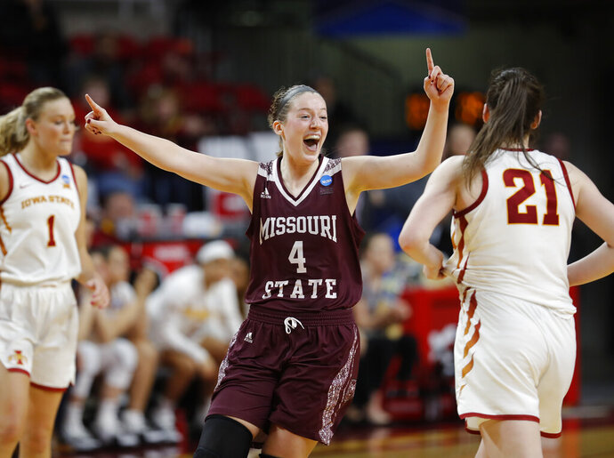 Missouri State forward Abby Hipp, center, celebrates the team's 69-60 win over Iowa State in a second-round game in the NCAA women's college basketball tournament Monday, March 25, 2019, in Ames, Iowa. (AP Photo/Matthew Putney)