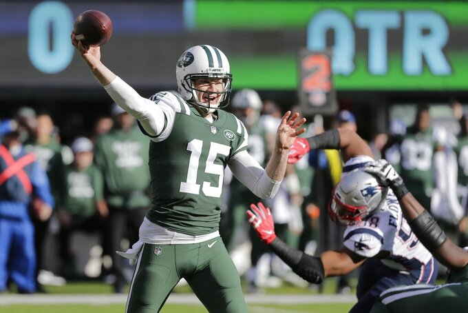 FILE - In this Nov. 25, 2018, file photo, New York Jets quarterback Josh McCown (15) throws a pass during the first half of an NFL football game against the New England Patriots, in East Rutherford, N.J. McCown has announced he is retiring from playing football after an NFL career that spanned 16 NFL seasons and included stints with 10 teams. McCown, who turns 40 on July 4, writes in a piece for The Players' Tribune on Monday, June 17, 2019, that he will be helping coach his two sons — also quarterbacks — in high school this year.(AP Photo/Seth Wenig, File)