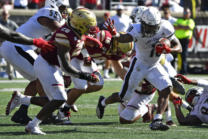 Louisville running back Javian Hawkins (10) reaches out to fend off Boston College linebacker John Lamot (28) during the second half of an NCAA college football game in Louisville, Ky., Saturday, Oct. 5, 2019. Louisville won 41-39. (AP Photo/Timothy D. Easley)
