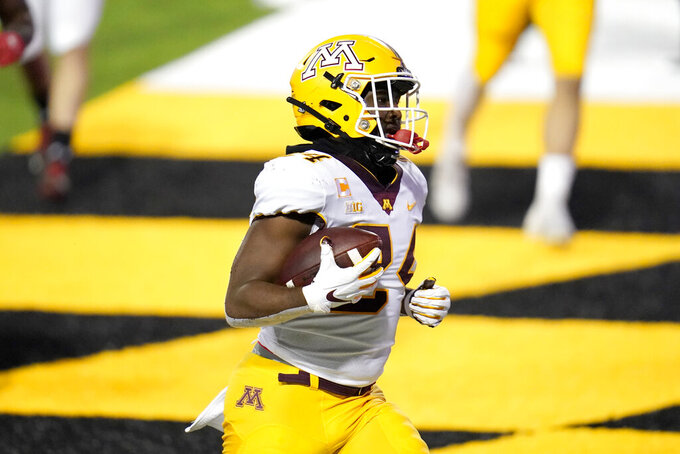 Minnesota running back Mohamed Ibrahim runs for a touchdown against Maryland during the first half of an NCAA college football game, Friday, Oct. 30, 2020, in College Park, Md. (AP Photo/Julio Cortez)