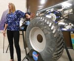 Heather Oravec, research associate professor stationed at the NASA Glenn Research Center, talks about a lunar rover vehicle wheel in the Simulated Lunar Operations Lab in Cleveland on Sept. ,9, 2019. Oravec's research in extraterrestrial soil mechanics and extraterrestrial surface mobility helps in developing new tires for off world vehicles and rovers. (Mike Cardew/Akron Beacon Journal via AP)