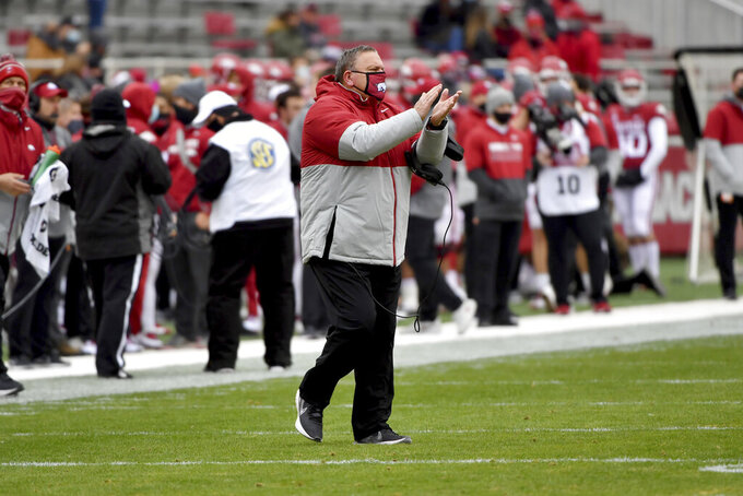 Arkansas coach Sam Pittman reacts after a big play against Alabama during the first half an NCAA college football game Saturday, Dec. 12, 2020, in Fayetteville, Ark. (AP Photo/Michael Woods)