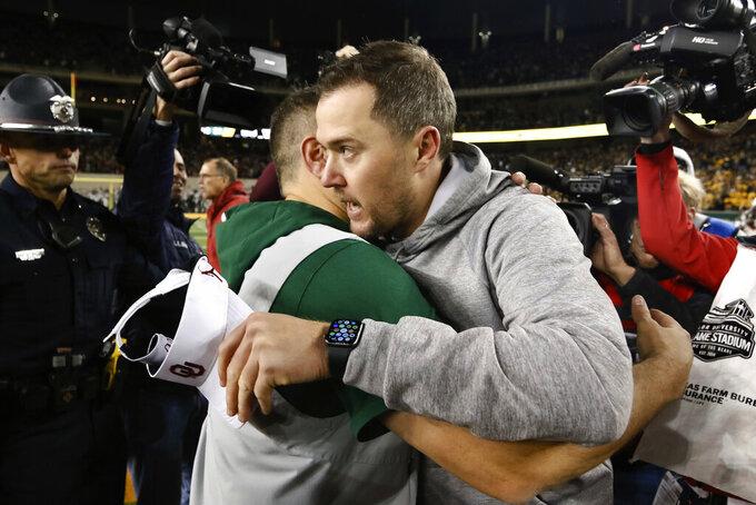 Baylor head coach Matt Rhule, left, and Oklahoma head coach Lincoln Riley hug after an NCAA college football game in Waco, Texas, Saturday, Nov. 16, 2019. Oklahoma won 34-31. (AP Photo/Ray Carlin)