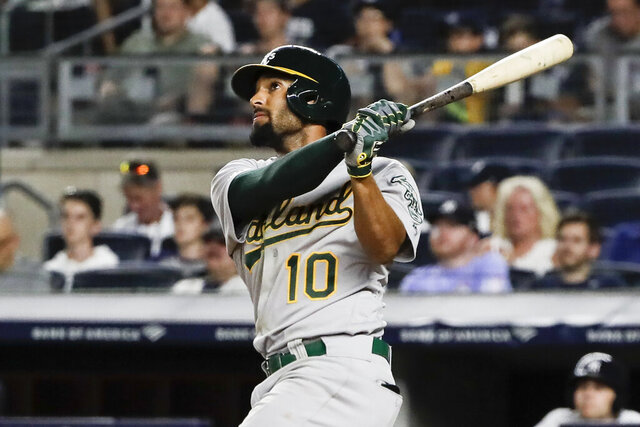 FILE - In this Aug. 30, 2019, file photo, Oakland Athletics' Marcus Semien watches his home run during the ninth inning of the team's baseball game against the New York Yankees in New York.  Following a career year, Semien was rewarded Friday, Jan. 10, with a $13 million, one-year contract that avoids arbitration and gives him a raise of $7.1 million. Semien played all 162 games for the first time in 2019 to help the A's win 97 games for a second straight season and the AL's top wild card. He finished third in MVP voting after putting up several personal bests: 33 homers and 92 RBIs while hitting .285. (AP Photo/Frank Franklin, File)