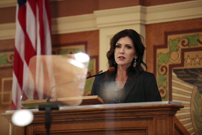 South Dakota Gov. Kristi Noem addresses the Legislature, Tuesday, Feb. 9, 2021, at the Capitol in Pierre. (AP Photo/Stephen Groves)