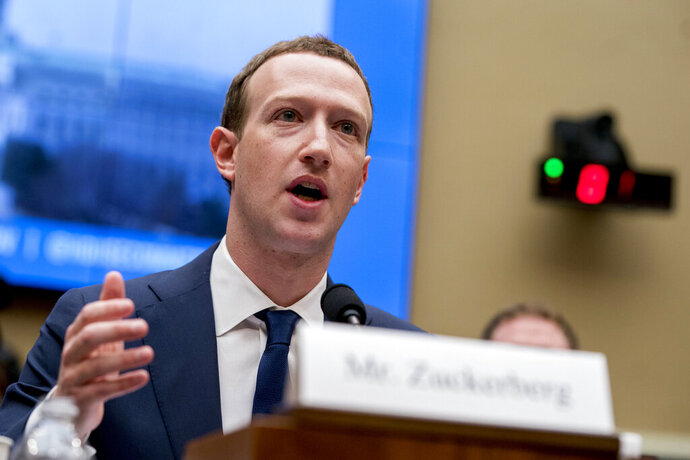FILE - In this April 11, 2018, file photo, Facebook CEO Mark Zuckerberg testifies before a House Energy and Commerce hearing on Capitol Hill in Washington about the use of Facebook data to target American voters in the 2016 election and data privacy. Zuckerberg will be in Washington Thursday, Sept. 19, 2019, to meet with lawmakers and talk about internet regulation. The company said the meetings are not public and it did not give details on whom Zuckerberg is meeting with and what, exactly, he'll discuss. (AP Photo/Andrew Harnik, File)