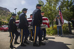 Military personnel carry the remains of Army Sgt. 1st Class Elliott Robbins in a funeral procession on Thursday, July 18, 2019 in Ogden, Utah. Robbins died in a non-combat incident on June 30 while serving in Afghanistan. (Ben Dorger/Standard-Examiner via AP)