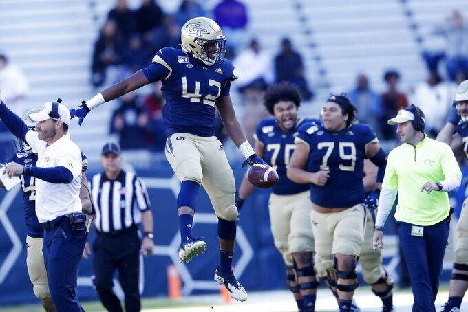 Georgia Tech linebacker Jordan Domineck (42) reacts after recovering a fumble in the first half of an NCAA college football game against the Pittsburgh Saturday, Nov. 2, 2019, in Atlanta. (AP Photo/John Bazemore)