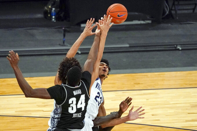 Georgetown center Qudus Wahab (34) and Villanova forward Jermaine Samuels (23) vie for a rebound during the first half of an NCAA college basketball game in the quarterfinals of the Big East conference tournament, Thursday, March 11, 2021, in New York. (AP Photo/Mary Altaffer)