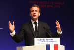 FILE - In this Oct. 30, 2019, file photo, French President Emmanuel Macron delivers a speech during the Global forum on Artificial Intelligence (AI) for Humanity (GFAIH) at the Institut de France in Paris. Macron is visiting China amid a push for Beijing to open its markets, despite festering trade disputes and weakened consumer spending. (Ludovic Marin, Pool via AP, File)