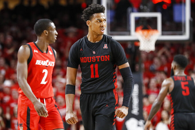 Houston's Nate Hinton (11) reacts in the second half of an NCAA college basketball game against Cincinnati, Sunday, March 10, 2019, in Cincinnati. (AP Photo/John Minchillo)