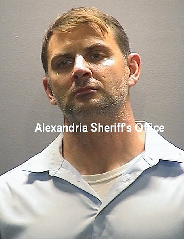 This booking photo provided by the Alexandria, Va, Sheriff's Office, shows Peter Rafael Dzibinski Debbins. A federal magistrate judge in Virginia has refused to free the former Army Green Beret who was arrested last week on a charge that he divulged U.S. military secrets to Russian intelligence agents. U.S. Magistrate Judge John Anderson agreed Thursday, Aug. 27, 2020 with federal prosecutors that Debbins, 45, poses a risk to flee if he is released from custody before trial. (Alexandria Sheriff's Office via AP)