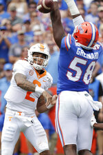 Florida linebacker Jonathan Greenard (58) knocks down a pass attempt by Tennessee quarterback Jarrett Guarantano, left, during the first half of an NCAA college football game, Saturday, Sept. 21, 2019, in Gainesville, Fla. (AP Photo/John Raoux)