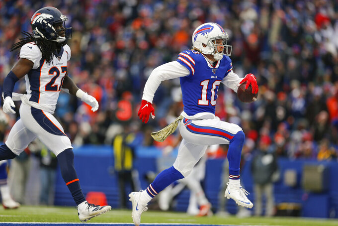 Buffalo Bills wide receiver Cole Beasley (10) crosses the goal line to score a touchdown ahead of Denver Broncos cornerback Davontae Harris during the third quarter of an NFL football game, Sunday, Nov. 24, 2019, in Orchard Park, N.Y. (AP Photo/John Munson)