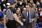 Duke coach Mike Krzyzewski speaks with an official during the first half of the team's NCAA college basketball game against Boston College in Durham, N.C., Tuesday, Dec. 31, 2019. (AP Photo/Gerry Broome)