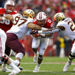 Wisconsin running back Jonathan Taylor (23) runs against Minnesota defensive lineman Royal Silver (97) and linebacker Kamal Martin (21) during the first half of an NCAA college football game Saturday, Nov. 24, 2018, in Madison, Wis. (AP Photo/Andy Manis)