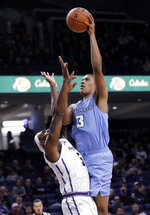 Columbia forward Patrick Tape, right, shoots against Northwestern center Dererk Pardon during the first half of an NCAA college basketball game Sunday, Dec. 30, 2018, in Evanston, Ill. (AP Photo/Nam Y. Huh)
