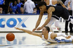 San Diego guard Tyler Williams, below, reaches for a loose ball as Gonzaga forward Jeremy Jones defends during the first half of an NCAA college basketball game Saturday, Feb. 16, 2019, in San Diego. (AP Photo/Gregory Bull)
