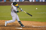 Oakland Athletics' Ramon Laureano swings for a two-run home run during the ninth inning of the team's baseball game against the Los Angeles Dodgers on Wednesday, Sept. 23, 2020, in Los Angeles. (AP Photo/Marcio Jose Sanchez)