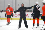 Philadelphia Flyers head coach Alain Vigneault directs his players during an NHL hockey practice in Voorhees, N.J., Tuesday, Jan. 5, 2021.  ( (David Maialetti/The Philadelphia Inquirer via AP)