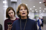 FILE - In this Jan. 10, 2019, file photo, Sen. Lisa Murkowski, R-Alaska, answers questions from reporters on Capitol Hill in Washington. Murkowski said she's comfortable waiting to decide if more information is needed as part of the Senate's impeachment trial until after hearing arguments from House managers and attorneys for President Donald Trump and questions from members. Murkowski spoke to reporters Saturday, Jan. 18, 2020, from Anchorage ahead of Senate impeachment trial proceedings expected to begin Tuesday. (AP Photo/J. Scott Applewhite, File)