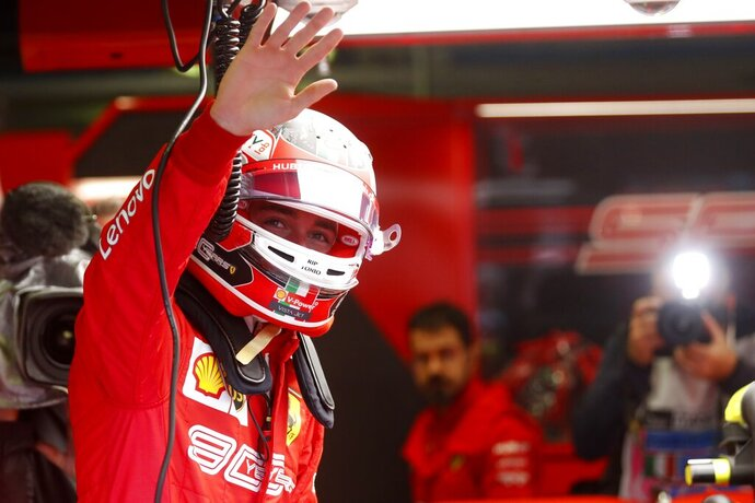 Ferrari driver Charles Leclerc of Monaco waves during the first free practice at the Monza racetrack, in Monza, Italy, Friday, Sept. 6, 2019. The Formula one race will be held on Sunday. (AP Photo/Antonio Calanni)