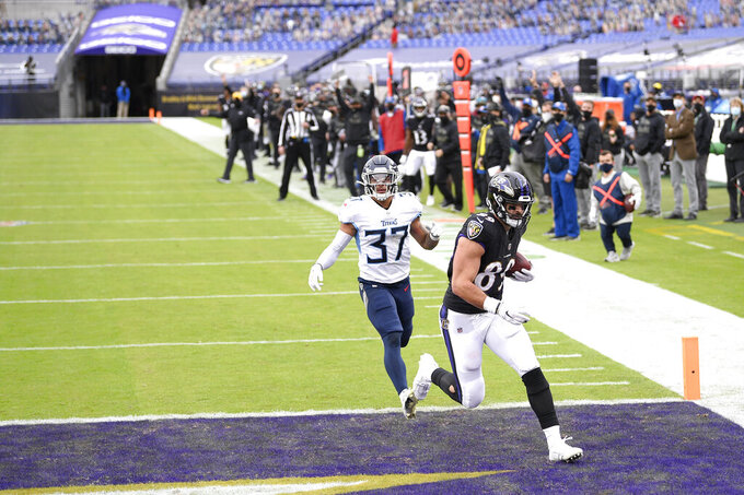 Baltimore Ravens tight end Mark Andrews, right, scores on a touchdown pass from quarterback Lamar Jackson, not visible, as Tennessee Titans safety Amani Hooker (37) tries to defend during the second half of an NFL football game, Sunday, Nov. 22, 2020, in Baltimore. (AP Photo/Nick Wass)