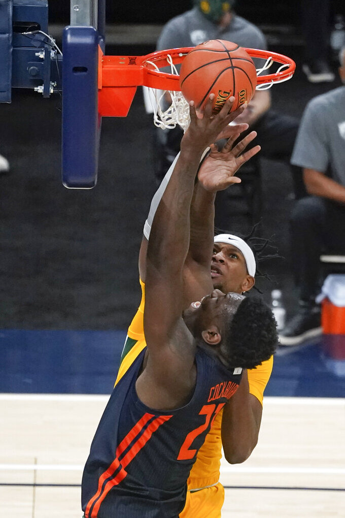 Illinois' Kofi Cockburn (21) puts up a shot against Baylor's Flo Thamba (0) during the first half of an NCAA college basketball game, Wednesday, Dec. 2, 2020, in Indianapolis. (AP Photo/Darron Cummings)