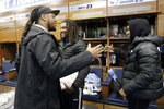 Tennessee Titans running back Derrick Henry, left, says goodbye to cornerback Tye Smith, center, and cornerback Adoree' Jackson, right, as players clean out their lockers Monday, Jan. 20, 2020, in Nashville, Tenn. The Titans lost the AFC Championship NFL football game Sunday to the Kansas City Chiefs. (AP Photo/Mark Humphrey)