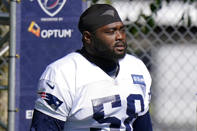 New England Patriots offensive lineman Mike Onwenu (58) steps on the field for an NFL football training camp practice, Sunday, Aug. 30, 2020, in Foxborough, Mass. (AP Photo/Steven Senne, Pool)