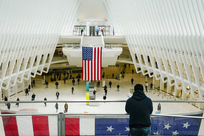 People walk inside of The Occulus Tuesday, Feb. 16, 2021, in New York. (AP Photo/Frank Franklin II)