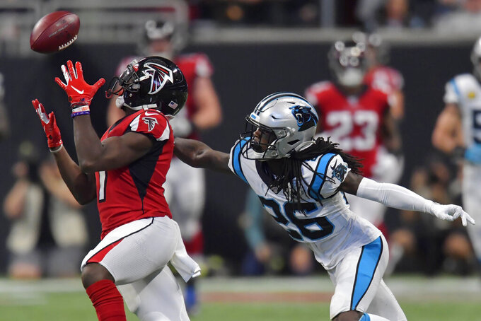 Atlanta Falcons wide receiver Olamide Zaccheaus (17) makes the catch against Carolina Panthers cornerback Donte Jackson (26) during the second half of an NFL football game, Sunday, Dec. 8, 2019, in Atlanta. (AP Photo/Mike Stewart)
