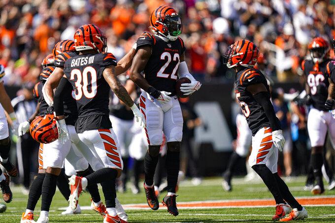 Cincinnati Bengals cornerback Chidobe Awuzie (22) celebrates an interception against the Green Bay Packers in the first half of an NFL football game in Cincinnati, Sunday, Oct. 10, 2021. (AP Photo/Bryan Woolston)