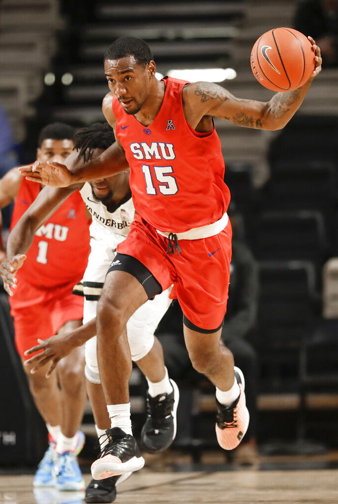 SMU forward Isiaha Mike (15) heads up the court after stealing the ball during the first half of the team's NCAA college basketball game against Vanderbilt on Saturday, Jan. 4, 2020, in Nashville, Tenn. (AP Photo/Mark Humphrey)