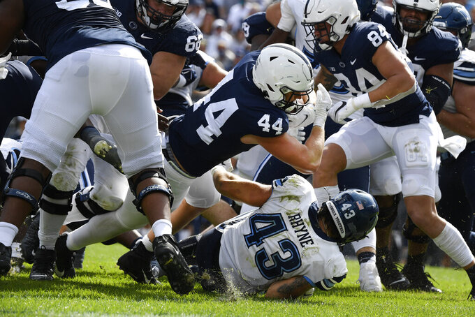 Penn State tight end Tyler Warren (44) dives over Villanova linebacker Forrest Rhyne (43) to score a third quarter touchdown during an NCAA college football game in State College, Pa., on Saturday, Sept. 25, 2021. Penn State defeated Villanova 38-17. (AP Photo/Barry Reeger)