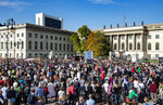 Thousands of people protest on Sunday, Oct. 13, 2019 in Berlin, Germany, against rising anti-Semitism, days after a man attacked a synagogue in the eastern German city of Halle. More than six thousand participated in the march through the German capital on Sunday. (Paul Zinken/dpa via AP)