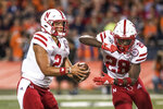 Nebraska quarterback Adrian Martinez (2) fakes a handoff to Maurice Washington (28) in the first half of an NCAA college football game against Nebraska, Saturday, Sept.21, 2019, in Champaign, Ill. (AP Photo/Holly Hart)