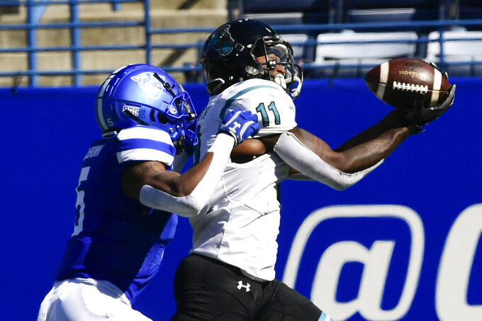 Coastal Carolina's Kameron Burton (11) makes a touchdown catch as Georgia State cornerback Bryquice Brown defends during the second half of an NCAA football game Saturday, Oct. 31, 2020, in Atlanta. Coastal Carolina won 51-0. (AP Photo/John Amis)