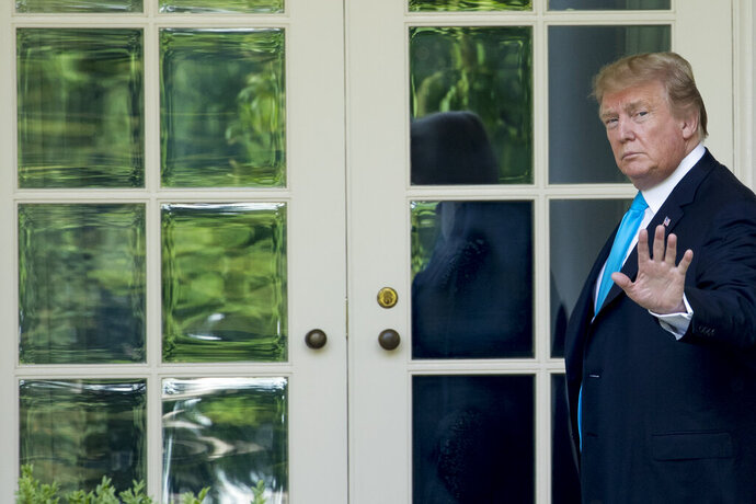 President Donald Trump waves as he walks towards the Oval Office in Washington, Thursday, May 23, 2019, after visiting the annual Flags In ceremony at Arlington National Cemetery. (AP Photo/Andrew Harnik)