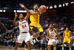 Arizona State's Remy Martin (1) shoots as St. John's Nick Rutherford (24) defends during the first half of an NCAA college basketball game, Saturday, Nov. 23, 2019, in Uncasville, Conn. (AP Photo/Jessica Hill)